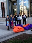 Karth family with 10,000 petitions outside U.S. DOT before their meeting